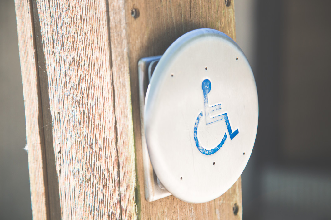 accessibility sign hanging on the wall